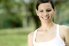 Outdoor Woman. A young woman standing in a park (shallow depth of field used royalty free stock photos
