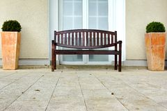 Outdoor Wood Bench At  The Wall On The Tilled Floor Royalty Free Stock Image