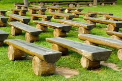 Outdoor wood seating Stock Images