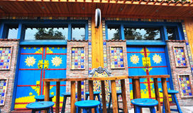 Outdoor wooden cafe seats Royalty Free Stock Photography