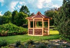 Outdoor wooden gazebo. Over summer landscape background royalty free stock images