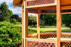 Outdoor wooden gazebo. Over summer landscape background stock photography
