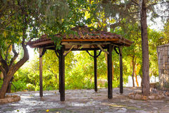 Outdoor wooden gazebo with summer landscape background Stock Photos