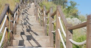 Outdoor wooden stair going up. The hill. Nature park in Turkey, near Antalya, Carain cave stock footage