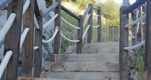 Outdoor wooden stair going up. The hill. Spring time stock video