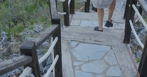 Outdoor wooden stair. Going down the hill stock footage