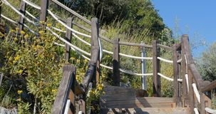 Outdoor wooden stair. Going up the hill stock footage