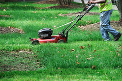 Outdoor worker mowing the lawn stock photography