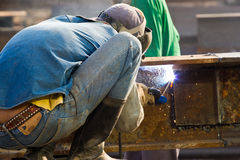 Outdoor worker with protective mask welding metal and sparks. At chonburi thailand Stock Photo