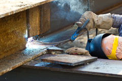 Outdoor worker with protective mask welding metal and sparks. At thailand Stock Photography