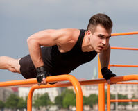 Outdoor workout on bars. Royalty Free Stock Images