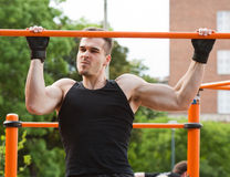 Outdoor workout on bars. Stock Photo