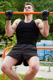 Outdoor workout on bars. Stock Photos