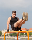 Outdoor workout on bars. Royalty Free Stock Photo