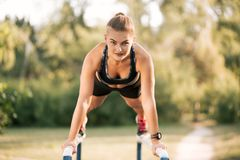 Outdoor Workout Exercise. Workout Exercise. Close-up Of Healthy Handsome Active Woman With Fit Muscular Body Doing Push Ups Exercises. Sporty Athletic Female Stock Photo