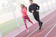 Outdoor workout. Sport, workout. Lovely couple on the stadium Stock Photo
