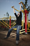 Summer outdoor. Outdoor workout - young man posing on location of open air fitness royalty free stock photo
