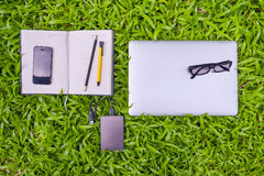 Outdoor workplace on grass field, Business concept Stock Photo