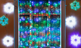 Outdoor Xmas garland decorate window Royalty Free Stock Photo