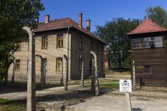 Outdoor yard in Auschwitz I camp with a guard tower Stock Photos