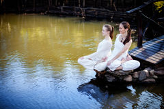 Outdoor yoga session in beautiful place by a lake Stock Photos