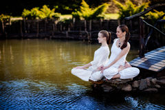 Outdoor yoga session in beautiful place by a lake Stock Photography