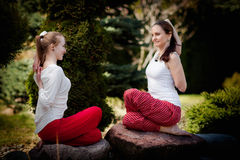 Outdoor yoga session in beautiful place - women exercise Royalty Free Stock Photography