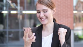 Outdoor Young Businesswoman Excited for Success on Smartphone. 4k high quality, 4k high quality stock video footage
