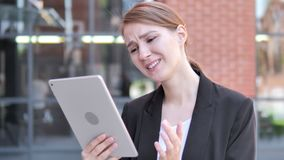 Outdoor young Businesswoman Upset by Loss on Tablet. 4k high quality, 4k high quality stock footage