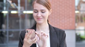 Outdoor Young Businesswoman Using Smartphone. 4k high quality, 4k high quality stock video footage