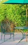 Outdoors. Lawn table and chair on summer day Royalty Free Stock Photo
