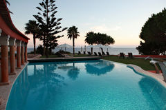 Outdoors. A beautiful swimming-pool in the coastline at dusk Royalty Free Stock Photography