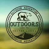 Outdoors Adventure Badge. With blurred background. Vector illustration stock illustration