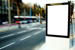 Outdoors advertising mock up, public information board on city road Royalty Free Stock Images