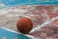 Outdoors basketball on old floor broken royalty free stock images