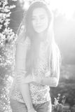 Outdoors black-white portrait of beautiful young long hair brunette woman Stock Images