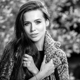 Outdoors black-white portrait of beautiful young long hair brunette woman. Stock Image