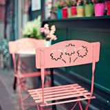 Outdoors cafe in Paris. Chairs and table of an outdoors cafe in Paris Stock Photography