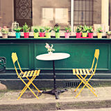 Outdoors cafe in Paris. Tables and chairs of an outdoors cafe in Paris Stock Photos