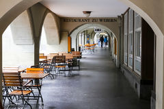 The outdoors cafe under arcades in Bern. Bern, Switzerland - April 17, 2017: The outdoors cafe under arcades, vacant places are there. Arcades of the old town Royalty Free Stock Photos