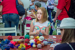 Outdoors children activity - knitting workshop Royalty Free Stock Photo