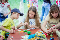 Outdoors children activity - knitting workshop Stock Photo