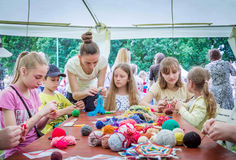 Outdoors children activity - knitting workshop Royalty Free Stock Image