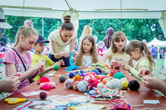 Outdoors children activity - knitting workshop Stock Images