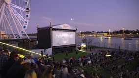 Outdoors cinema movies theater on the waterfront at night time