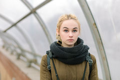 Outdoors city portrait of young blonde hipster woman Stock Image