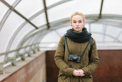 Outdoors city portrait of young blonde hipster woman photographer Stock Image