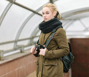 Outdoors city portrait of young blonde hipster woman photographer Royalty Free Stock Photography