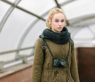 Outdoors city portrait of young blonde hipster woman photographer Royalty Free Stock Images