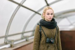 Outdoors city portrait of young blonde hipster woman photographer Stock Photos